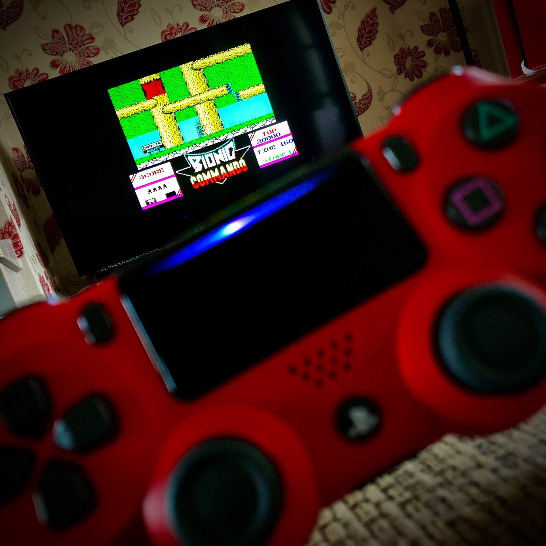 Sony PlayStation Dualshock 4 being used to play Bionic Commando