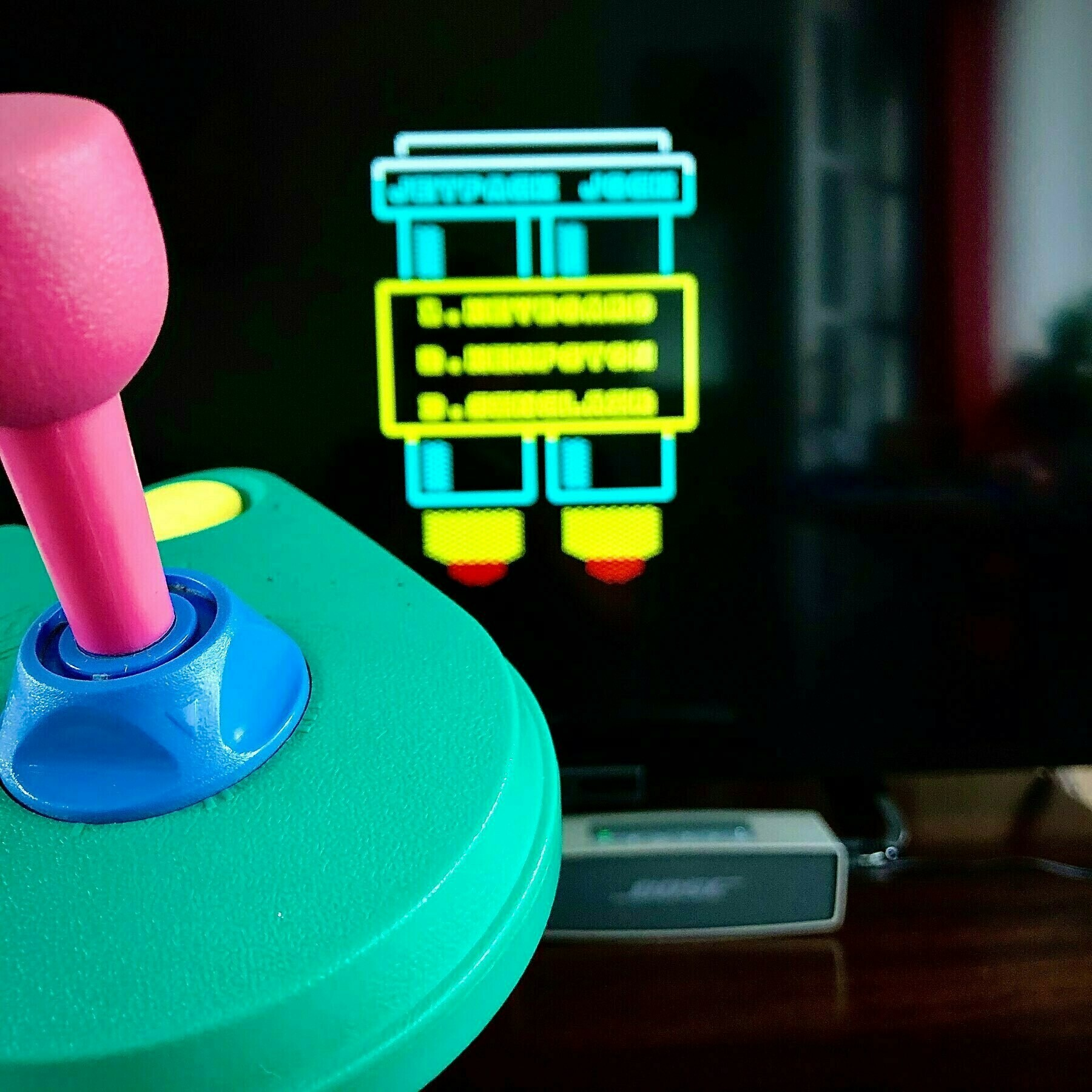 "garish green pink yellow and blue Cruiser joystick set to ""II"""