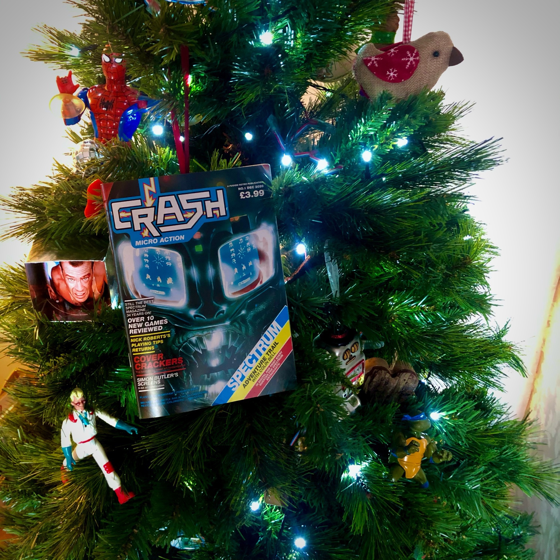 christmas tree decorated with 1980s toys and a 2020 copy of Crash magazine