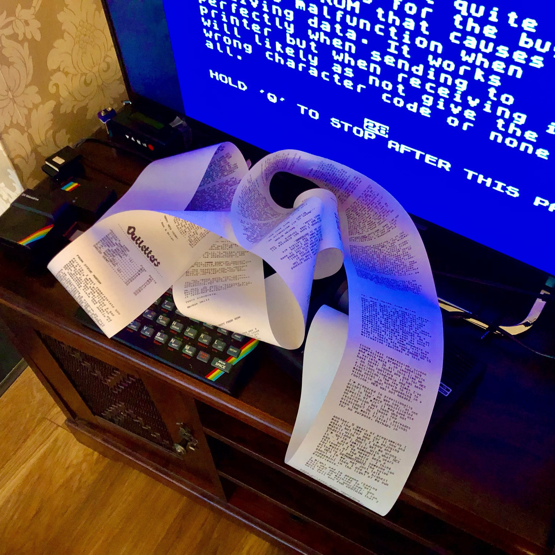 ZX Spectrum printing out on an Alphacom 32 and a long ream of thermal printer paper